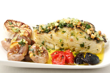 Traditional portuguese christmas dish-roasted cod fish isolated