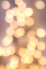 Abstract  background with glowing magic bokeh, defocused holiday
