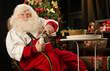 Santa Claus eating cookies with milk