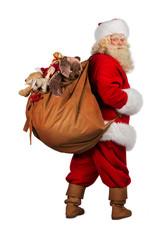 Real Santa Claus carrying big bag full of gifts from behind