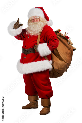 Real Santa Claus carrying big bag full of gifts