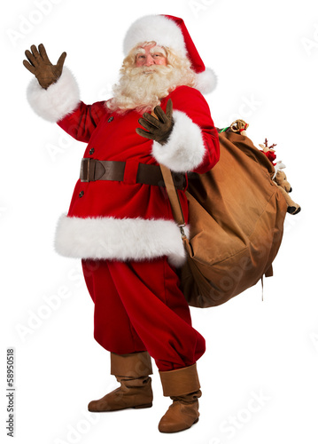 Real Santa Claus carrying big bag full of gifts, isolated on whi - 58950518
