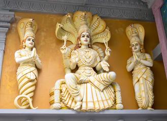 Hindu God Pantajali Statue with cobra snakes