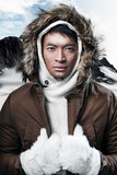 Asian winter sport fashion man in snow mountain landscape. Weari
