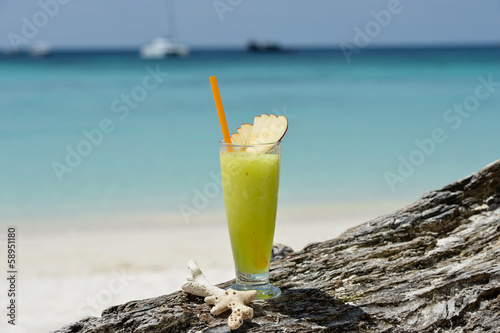 Fresh fruit cocktail juice on the beach