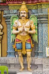 Hindu man looking God Statue at the Temple