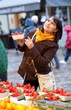 Beautiful girl selecting strawberries at market