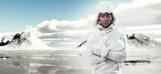 Asian winter fashion man in snow mountain landscape. Wearing whi