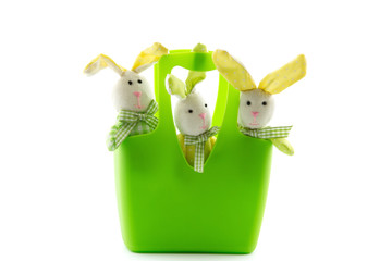 three toy Easter Bunnies in a basket