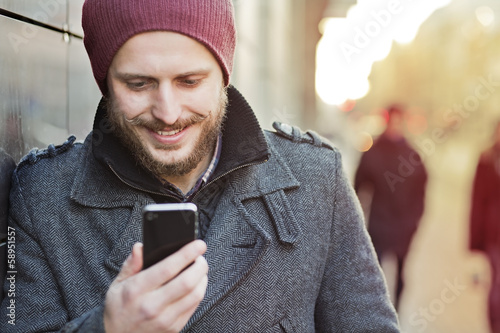 Young man with smartphone