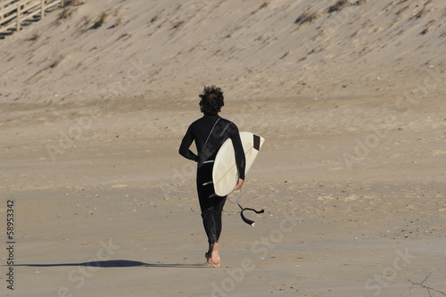 back surfer man in the beach sand