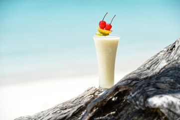 Milk cocktail on wood at beach - vacation background