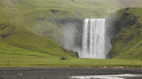 Skogafoss waterfall and tractor plowing field. Iceland. South ar poster