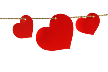 hearts hanging on a golden twine