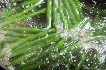 Green beans cooking in boiling water