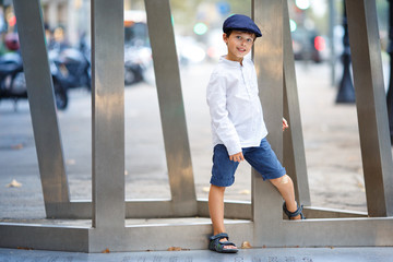 Cute little boy walking outdoors in city