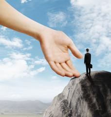 businessman standing on mountain