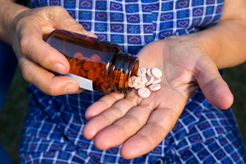 Drugs in old woman's hands