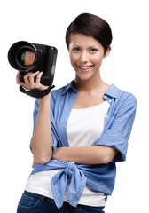 Lady takes images holding photographic camera