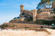Beach and medieval castle in Tossa de Mar, Spain