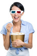 Girl watching 3D movie in glasses with bowl full of popcorn