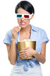 Girl watching 3D cinema in spectacles with bowl full of popcorn