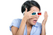 Scared girl in 3D glasses watches film through hands