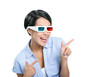 Pointing with forefingers girl in 3D spectacles, isolated