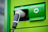 Detail of green ecological plug in for cars poster