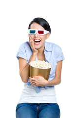 Viewer watching 3D film in spectacles with bowl full of popcorn