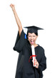 Graduating student gesturing fist with the diploma, isolated