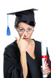 Graduating student in glasses with the diploma, isolated
