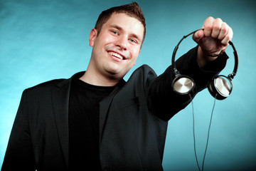 music and technology, smiling man offering headphones