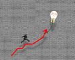 Businessman jumping on growth red arrow with glowing lamp balloo