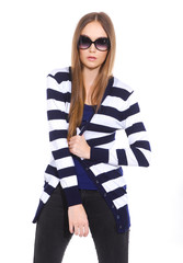 Pretty young woman in stripy shirt with sunglasses posing