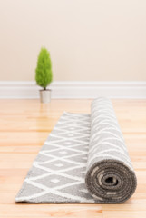 Unrolling carpet in a new home