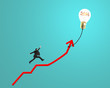 Businessman running on growth red arrow with glowing lamp balloo