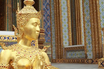 Golden Kinnari Statue in Grand Palace, Thailand
