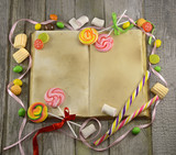 Open cook book with sweets