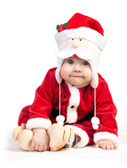 Cute little boy in Santa costume over white
