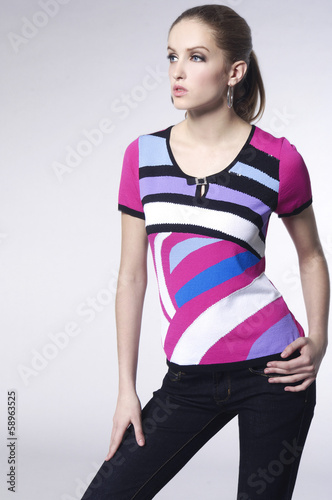 Pretty young woman in stripy shirt posing