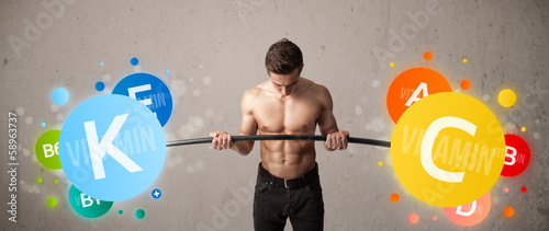 muscular man lifting colorful vitamin weights