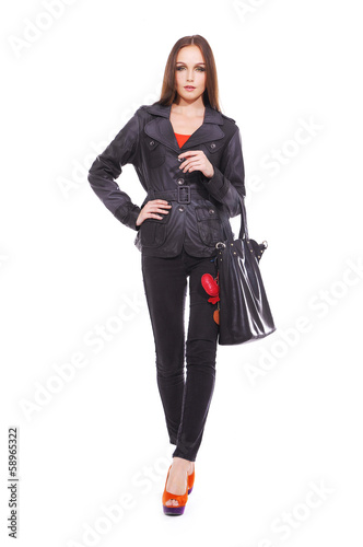 full length Slim pretty young girl with bag walking