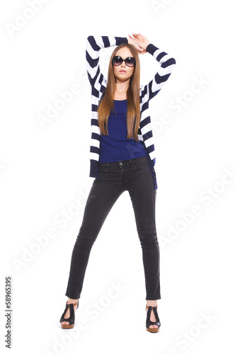 pretty young woman in stripy shirt posing in studio