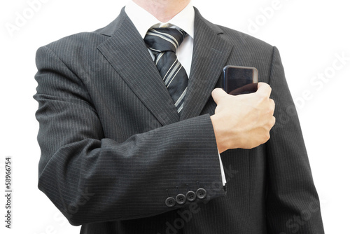 Businessman putting big smart phone into pocket