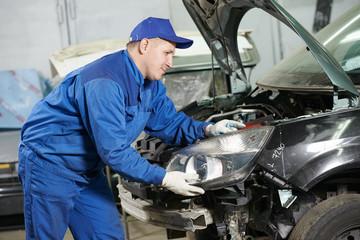 auto mechanic at repair work