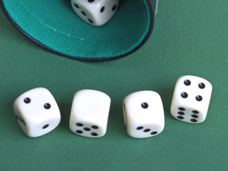 Dices on a green background.