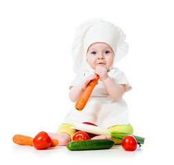 baby girl with vegetables