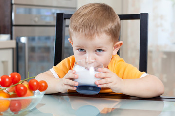 child drinking yogurt or kefir