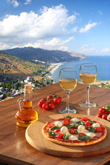 Sicily with pizza and white wine, Taormina, Italy